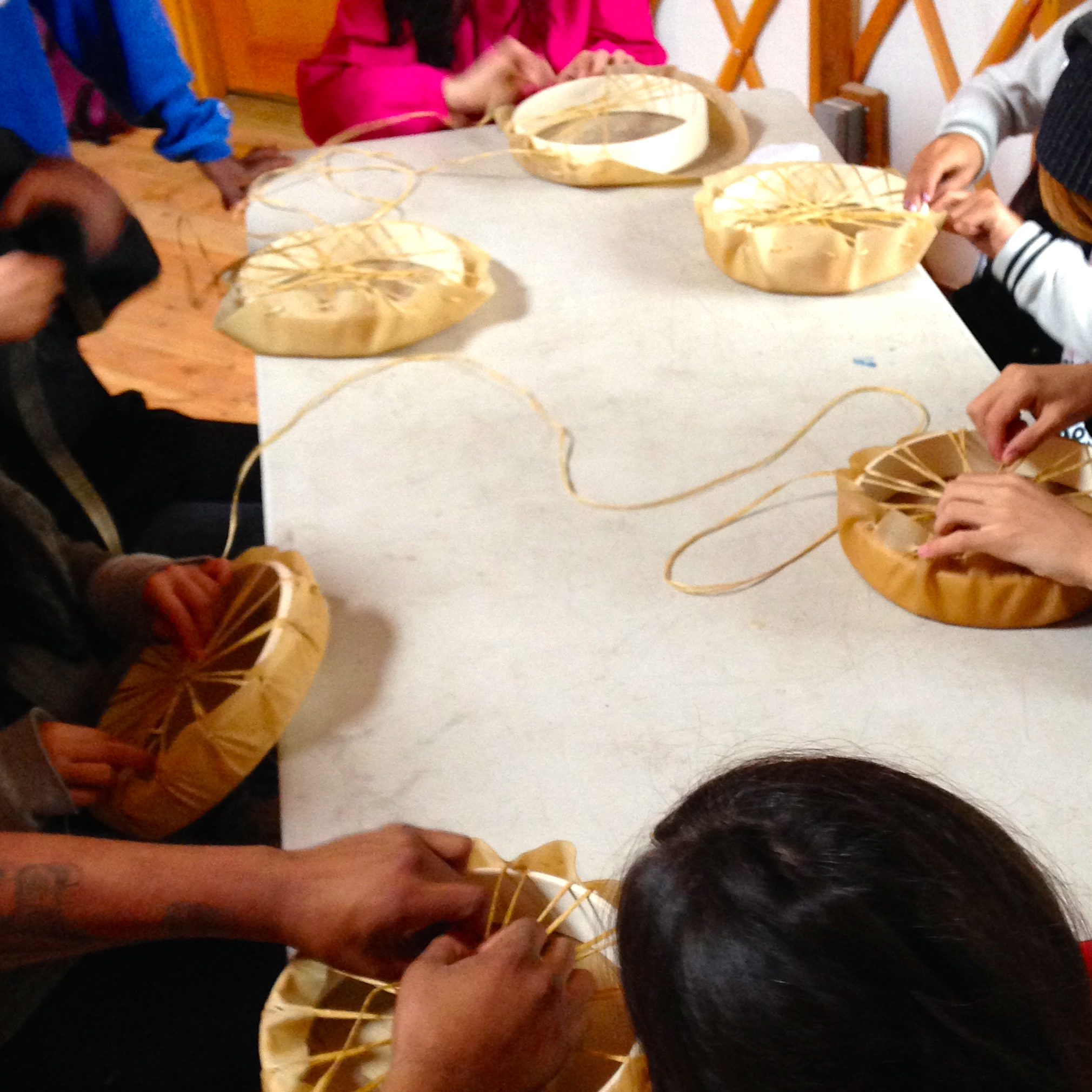 Youth learn to make their own drums in the UBC Farm Yurt